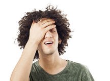 Regretful young man. Portrait of young man on isolated Royalty Free Stock Photos