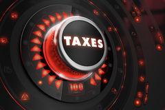 Regulador de los impuestos en la consola negra Fotografía de archivo libre de regalías
