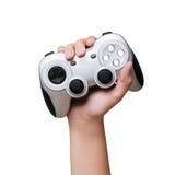 Regulador del juego a disposición criado para arriba Aislado en blanco Imagenes de archivo