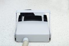Regulador dental del pie de la silla en un piso Imágenes de archivo libres de regalías