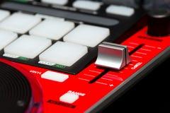 Regulador rojo del mezclador de DJ Foto de archivo libre de regalías