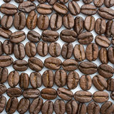 Regular abstract pattern made of coffee beans Royalty Free Stock Photo