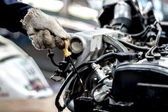 Hand holding is check oil engine. royalty free stock photo