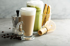 Regular coffee and matcha latte. On light background Stock Image