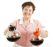 Regular or Decaf Coffee. Friendly smiling waitress offers a choice between regular or decaffeinated coffee. Isolated on white royalty free stock photos