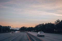 Regular evening car traffic on Sample Road at amazing sunset. Coral Springs, Florida USA - June 03, 2019: Regular evening car traffic on Sample Road at amazing stock photography