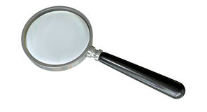 Magnifying Glass. A regular glass magnifying glass on an isolated background stock image