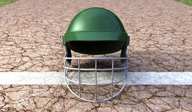 Cricket Helmet On Cracket Pitch Front Stock Photos