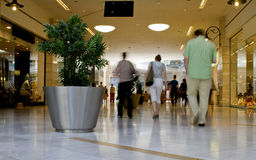 Regular mall scene. Regular busy mall interior scene with people walking Royalty Free Stock Photos