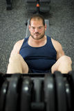 Regular man training legs in press gym machine Stock Images