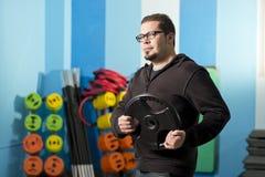 Regular man trining at gym Royalty Free Stock Photo