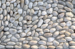 Regular pattern of cemented natural stones Royalty Free Stock Images