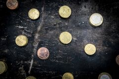 Regular Pattern Made Up Of Euro Coins On A Dark Black Background With Ripped Metal Details Stock Image