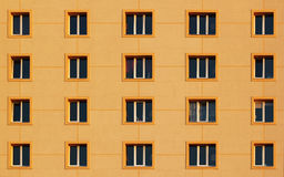 Regular pattern of windows in modern residential building Royalty Free Stock Photos