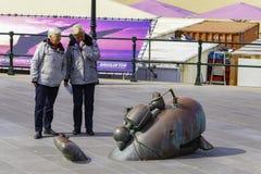Regular Senior couple walk and looking at a sculpture
