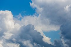 Regular spring clouds on blue sky at daylight in continental europe. Close shot with telephoto lens. Regular spring clouds on blue sky at daylight in continental stock photography