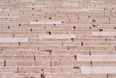 Regular steps. Grand staircase in white and pink stone with regular steps and processed stock photo