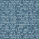Regular vectorial texture from ordered circles with random spaces on a blue background. Punch card stile. Stock Images