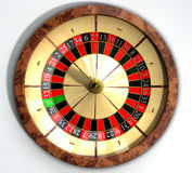 Roulette Wheel Close Top. A regular wood roulette wheel with red and black markers and gold detail on an isolated background royalty free stock images