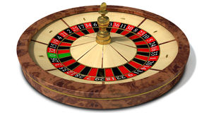 Roulette Wheel Perspective. A regular wood roulette wheel with red and black markers and gold detail on an isolated background stock image