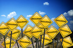Regulation concept on yellow road sign with blue sky Stock Photo
