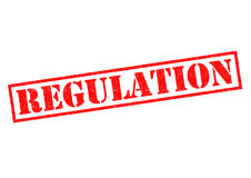 REGULATION. Red Rubber Stamp over a white background Stock Photos