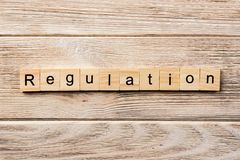 Regulation word written on wood block. regulation text on table, concept royalty free stock photography