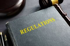 Regulations book and gavel. Law concept. stock photos