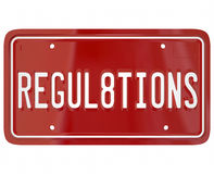 Regulations License Plate Word Auto Car Testing Safety. Regulations word on a red metal license plate for car or automobile illustrating the important rules and Stock Image
