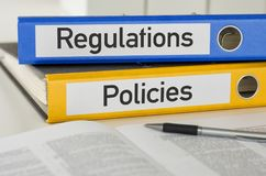 Regulations and Policies. Folders with the label Regulations and Policies Stock Images