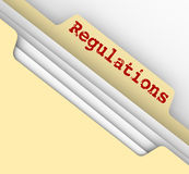 Regulations Word Red Ink File Manila Folder Tab Documents. Regulations word on the tab of a manila file folder containing documents of laws, guidelines, rules Stock Photo