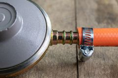 Regulator for propane-butane gas cylinder and accessories on a w royalty free stock photography