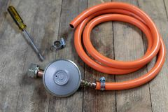Regulator for propane-butane gas cylinder and accessories on a w stock images
