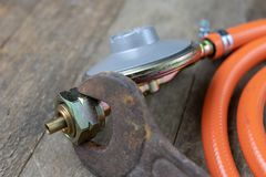 Regulator for propane-butane gas cylinder and accessories on a w stock photography