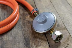 Regulator for propane-butane gas cylinder and accessories on a w stock photo