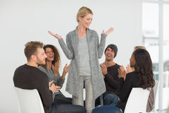 Rehab group applauding happy woman standing up Royalty Free Stock Image