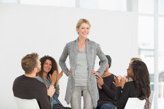 Rehab group applauding woman standing up royalty free stock image