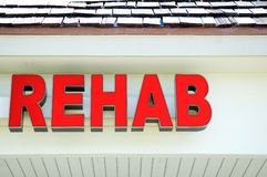 Rehab signage. A glowing red sign for rehabilitation and treatment unit