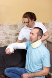 Rehab. An therapist helps a injured men in rehabilitation Stock Photo