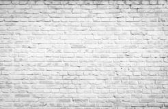 Texture background concept: white brick wall background in rural room. Rehabilitation concept: Silhouette a disabled man standing up and raising his crutches at royalty free stock images