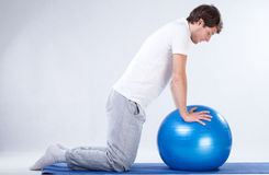 Rehabilitation exercises on fitness ball Royalty Free Stock Photos