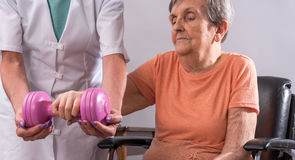 Rehabilitation physiotherapy exercises of an elderly woman Stock Images