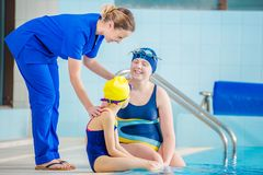 Rehabilitation Pool Session. With Children. Happy Children at the Rehabilitation Hospital Swimming Pool stock photo