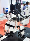 Rehabilitation robotic complex for restoration of walking skills. In exhibition royalty free stock photography