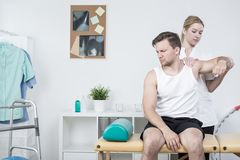 Rehabilitation at shoulder pain syndrome stock images