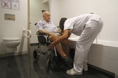Rehabilitation of a stroke. Patients who have suffered a stroke perform recovery activities with the help of nurses in the recovery program of the General Royalty Free Stock Image