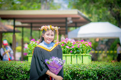 Rehearsal day. The image of the happy Thai girl student in her rehearsal day of the graduation ceremony Stock Photo