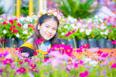 Rehearsal day. The image of Thai girl and flower background and foreground in her rehearsal day in Burapha University University in Thailand. Photo was taken on Stock Photography