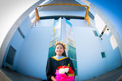 Rehearsal day. The portrait image of the happy Thai girl student in her rehearsal day of the graduation ceremony Stock Photo