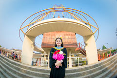 Rehearsal day. The portrait image of the happy Thai girl student in her rehearsal day of the graduation ceremony Royalty Free Stock Photo